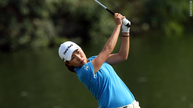 In-Kyung Kim plays her second shot at the ninth hole on the Majilis Course at the Emirates Golf Club.