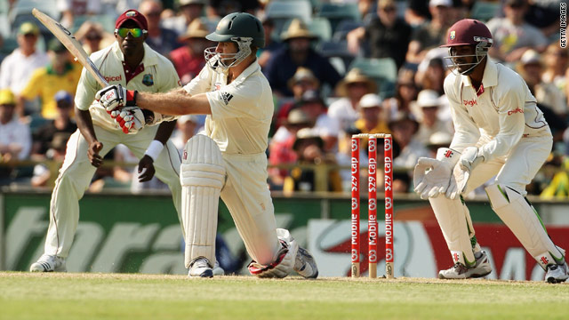 Australia batsman Simon Katich sweeps the ball to the boundary but fell one run short of a century against the West Indies.