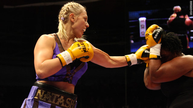 Natalia Ragozina, left, lands a punch against Pamela London during their heavyweight title fight in Yekaterinburg.
