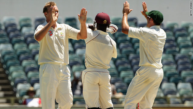 Bollinger celebrates taking the final wicket as Roach stands his ground at the WACA.