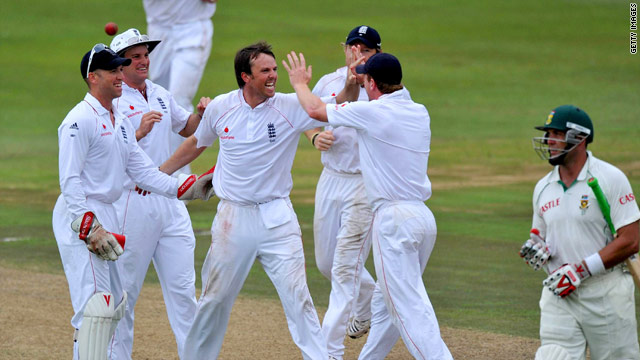 England players celebrate Swann's dismissal of the departing Kallis in Durban.