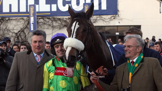 Just champion. Trainer Paul Nicholls (left), Ruby Walsh and owner Clive Smith in the winning enclosure with Kauto Star.