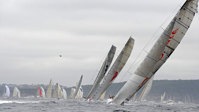 Alfa Romeo leads Wild Oats and ICAP Leopard out of Sydney Harbor at the start of the yachting classic.