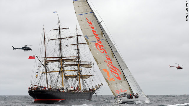 New Zealand supermaxi Alfa Romeo passes the historic James Craig on its way to victory in the Sydney to Hobart race.