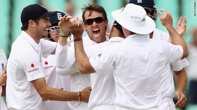 Graeme Swann (sunglasses) is congratulated by his team-mates after helping England to an innings victory over South Africa.