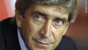 Real coach Manuel Pellegrini watched on as his side struggled against Gijon.
