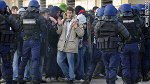 French police try to restore order as Marseille and PSG fans clash.
