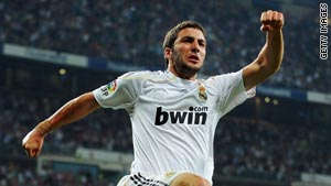 Real Madrid's two-goal hero Gonzalo Higuain celebrates after scoring against Getafe.