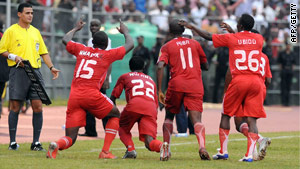 Heartland players celebrate their late winner against Mazembe in the African Champions League final first leg.