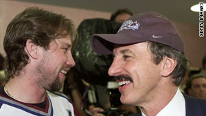 Kroenke (right) shares a moment withi ice hockey star Peter Forsberg at the Stanley Cup finals.