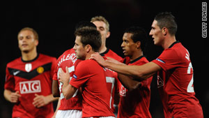 United players celebrate Valencia's late equalizer at Old Trafford.