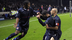 Lyon celebrate Lisandro Lopes' injury time equalizer in their 1-1 home draw with Liverpool.