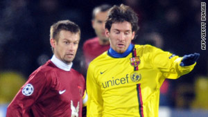 Lionel Messi (right) was well watched by the Rubin Kazan defence as Barcelona were held 0-0 in Russia.
