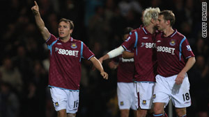 Mark Noble (left) celebrates his opening goal in West Ham's 2-1 victory over Aston Villa.
