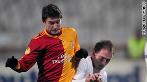 Galatasaray's Harry Kewell, left, vies for the ball with Manuel Scarlatache of Dinamo Bucaresti.