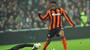 Goalkeeper of Toulouse FC Yohann Pele attempts to stop a ball against Luiz Adriano of FC Shakhtar on October 22, 2009.