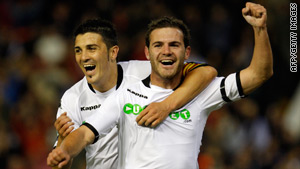 David Villa, left, and Juan Mata celebrate after Valencia's first goal in the win over Zaragoza.