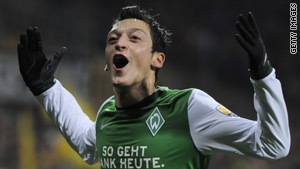 Werder Bremen midfielder Mezut Oezil celebrates after putting his team ahead against Dortmund.