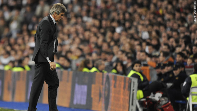 Real Madrid coach Manuel Pellegrini cut a lonely figure after his side's early exit in the Copa Del Rey.