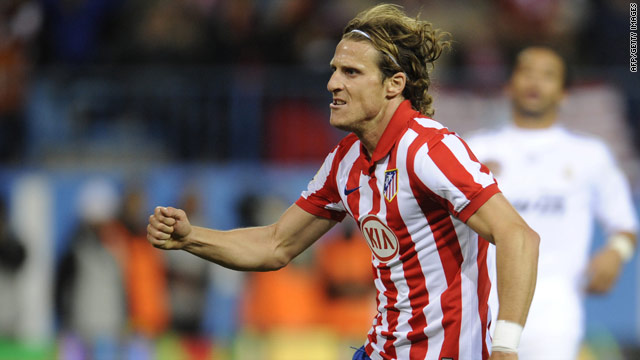 Forlan has signed a new contract that will keep him with Atletico Madrid until 2013.