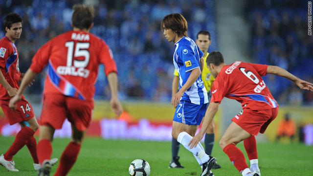 Shunsuke Nakamura of Espanyol is surrounded by Getafe players during their Spanish Cup match.