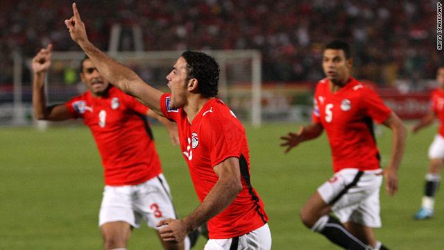 Egypt striker Amr Zaki celebrates after opening the scoring in the second minute of his side's dramatic 2-0 victory over Algeria.