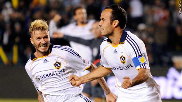 David Beckham, left, celebrates with Los Angeles Galaxy teammate Landon Donovan.