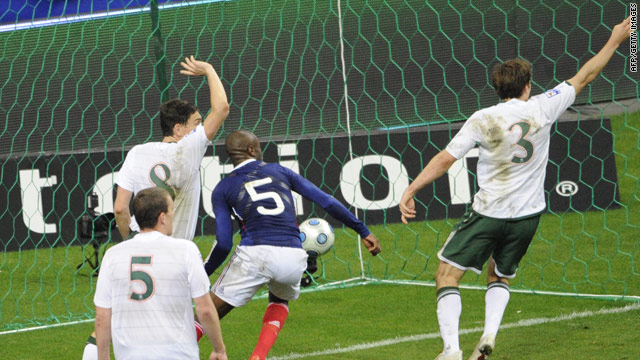 French defender William Gallas scores to put France through to the World Cup finals