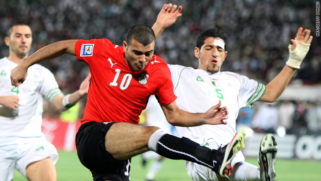 Algeria's Rafik Halliche, right, started the play-off despite being injured by rock-throwing Egypt fans.