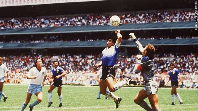 "Argentina legend Diego Maradona scores the ""Hand of God"" goal against England in 1986."