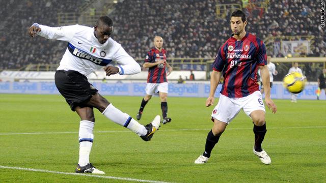 Inter Milan goalscorer Mario Balotelli fires a shot at the Bologna goal.