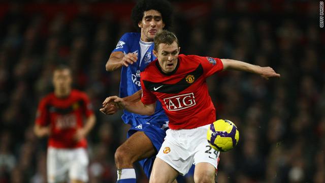 Manchester United midfielder Darren Fletcher shields the ball from Everton's Marouane Fellaini.