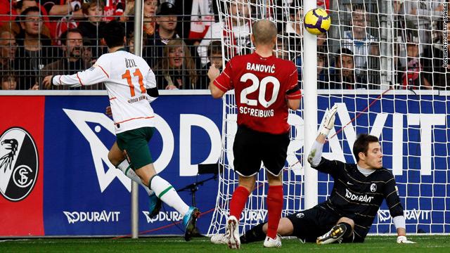 Mezut Ozil, left, hit the post before Werder Bremen opened the floodgates against Freiburg.