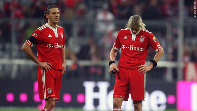 Dejected Bayern players face up to the reality of more dropped points at the Allianz Arena.