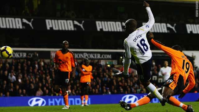 Jermain Defoe grabs his second of five in Tottenham's 9-1 thrashing of Wigan