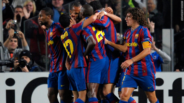 Barcelona celebrate scoring the opening goal as they edged towards qualification with a 2-0 victory over Inter Milan.