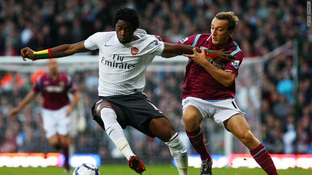 Alexandre Song (left) fends off the challenge of West Ham midfielder Mark Noble.