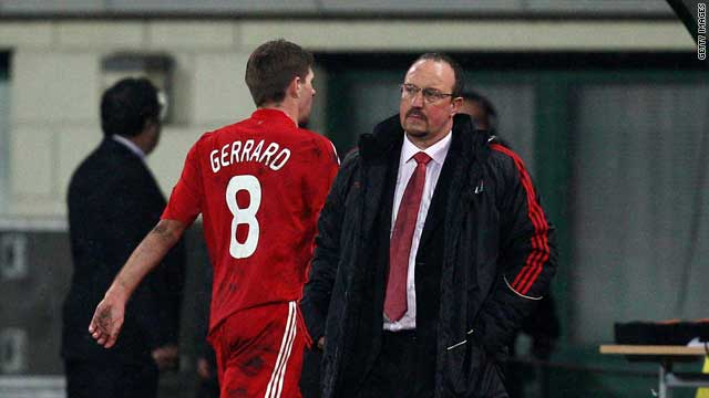Steven Gerrard walks by Rafa Benitez after being substituted in their 1-0 win over Debrecen.