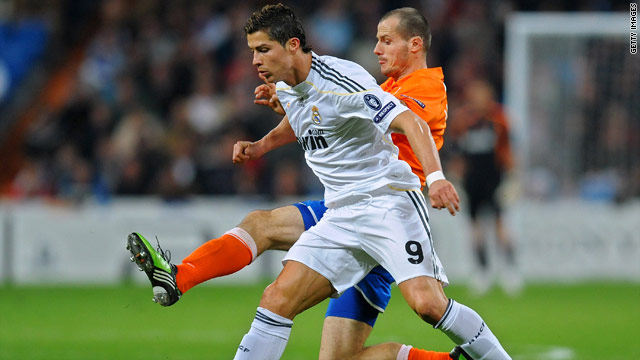 Real Madrid's record signing Cristiano Ronaldo tussles with  Xavier Margairaz of FC Zurich on Wednesday.
