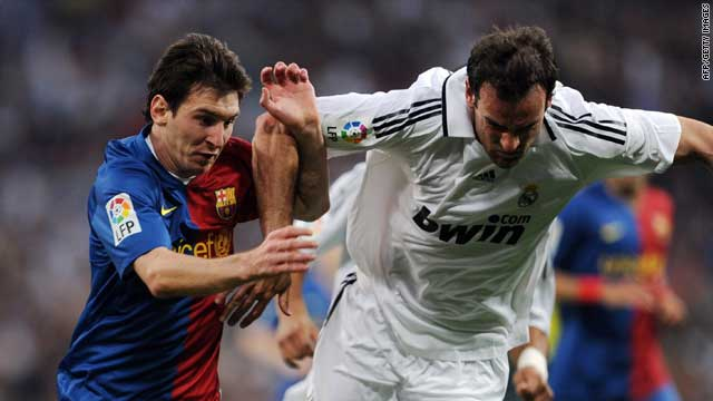 "Lionel Messi (left) and Christoph Metzelder compete for the ball during May 2009's ""El Clasico."""