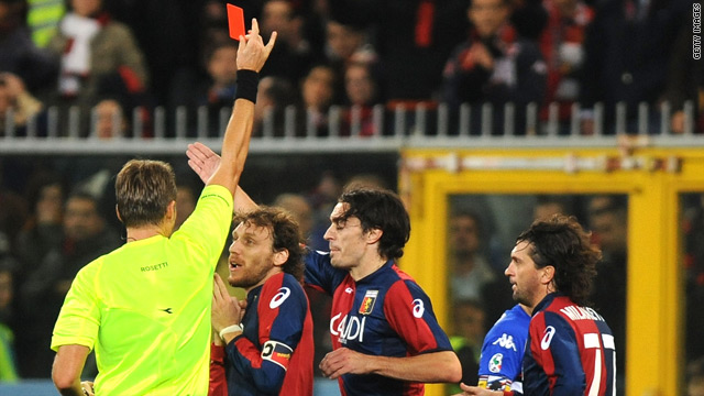 Marco Rossi (No. 7) of Genoa protests as referee Roberto Rosetti shows a red card to Giuseppe Biava.