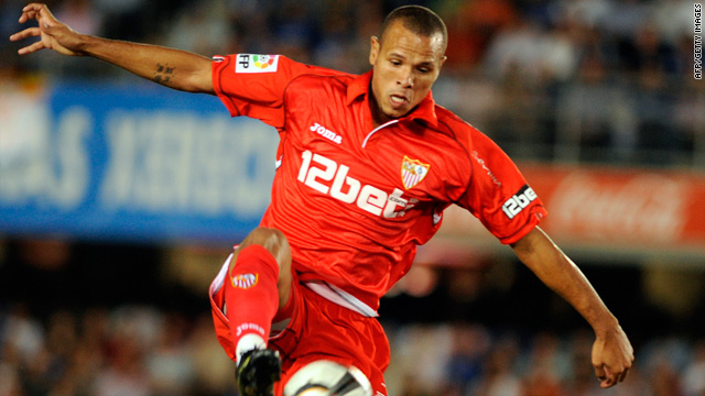 Prolific striker Luis Fabiano saved Sevilla's blushes with two second-half goals against lowly Malaga.