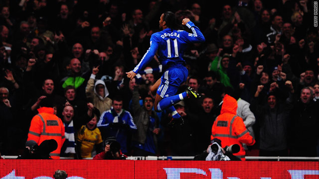 High flyer: Droba celebrates his opening goal for Chelsea at the Emirates in the 3-0 win.