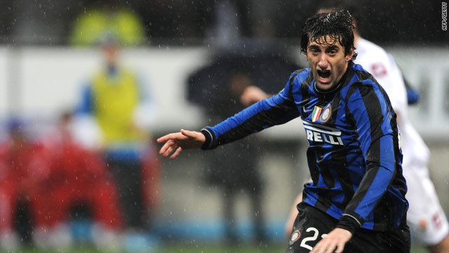 Milito celebrates after giving Inter the three points with a late penalty in the San Siro.