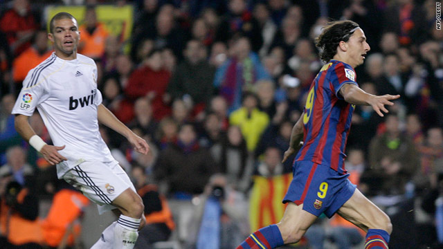 Real defender Pepe can only watch as Ibrahimovic (right) volleys the Barcelona winner.