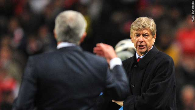 Arsene Wenger and Mark Hughes exchange words during an English League Cup quarterfinal tie.