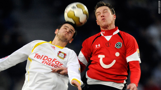 Leverkusen's Swiss midfielder Tranquillo Barnetta, left, vies for the ball with Hannover midfielder Hanno Balitsch.
