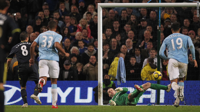 Frank Lampard, far left, sees his spot-kick saved by Manchester City goalkeeper Shay Given.