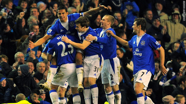Everton players celebrate Tim Cahill's equalizing goal in the 2-2 draw against Tottenham.