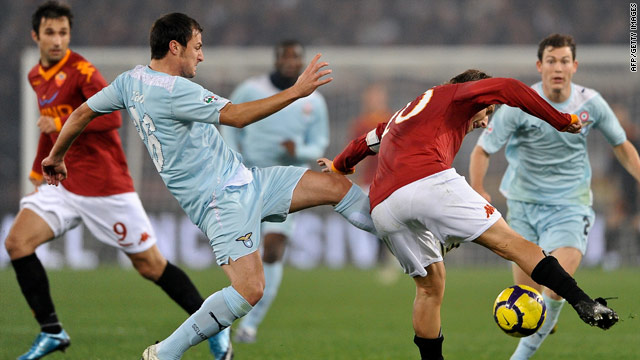 Roma captain Francesco Totti (right) challenges for the ball in a tight Rome 'derby' against Lazio.